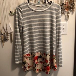 Striped shirt with floral detail.
